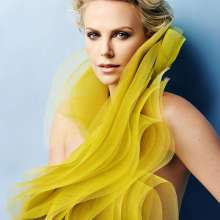 Charlize Theron in yellow fashion look